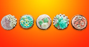 A row of colorful cupcakes view from the top Royalty Free Stock Image