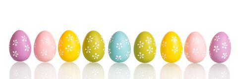 Row of colorful Easter eggs isolated on white. royalty free stock photos