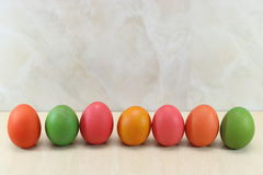 Row of colorful easter eggs on marble with copy space background. Royalty Free Stock Images