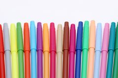 Row of colorful felt pens. Isolated on the white background Royalty Free Stock Image