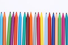 Row of colorful felt pens. Isolated on the white background Stock Image