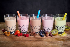 Row of colorful fruit and candy flavored boba tea Royalty Free Stock Photo