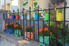 Row of colorful garden pots Royalty Free Stock Photos