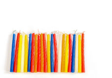 Row of colorful holiday candles Royalty Free Stock Image