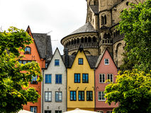 A row of colorful houses on the banks of the Rhine in front of the St. Martin Church in Cologne, Germany Royalty Free Stock Images