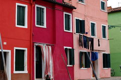 Row of colorful houses on the island Burano, Venice, Italy. Stock Photo