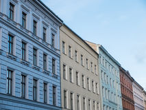 Row of Colorful Modern Low Rise Buildings. Architectural Exterior Detail of Row of Colorful Modern Low Rise Buildings in Urban Environment with Clear Blue Sky in Royalty Free Stock Photography