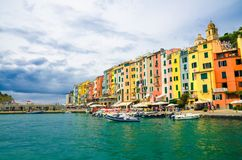Row of colorful multicolored buildings houses of Portovenere coastal town village and boats in harbor of Ligurian sea, Riviera di royalty free stock image