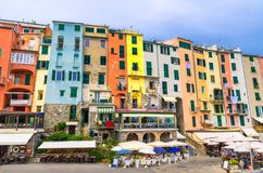 Row of colorful multicolored buildings houses and restaurants of Portovenere coastal town village in harbor of Ligurian sea, Rivie royalty free stock photography