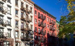 Row of colorful old apartment buildings in the East Village neighborhood of New York City stock photos