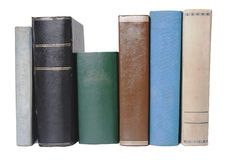 A row of colorful old books. In various sizes and colours, isolated on white background Stock Photo