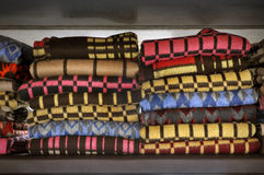Row of colorful patterned woolen blankets. Stock Photography