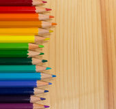 Row of colorful pencils rainbow order on wooden table Stock Photography