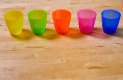 Row of colorful plastic cups Stock Image