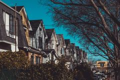 Row of colorful residential houses in Queens, NY. On clear, sunny day stock photos