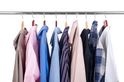 Row of colorful row shirts hanging on hangers Stock Image