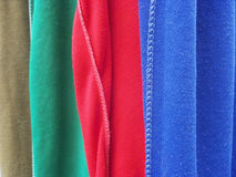 A row of colorful row t-shirts hanging on hangers Royalty Free Stock Photo
