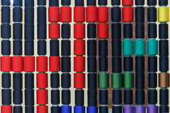 Row of colorful sewing thread Stock Photography