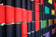 Row of colorful sewing thread Royalty Free Stock Photos