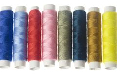 Row of colorful sewing threads Royalty Free Stock Photos