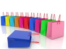 Row of colorful shopping bags. In backgrounds Royalty Free Stock Image