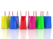 Row of colorful shopping bags on white. In backgrounds vector illustration