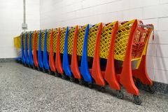 Row of colorful shopping trolley. In supermarket Royalty Free Stock Image
