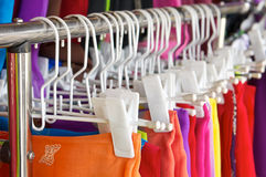 Row of colorful skirt with white clothes hanger Royalty Free Stock Photography