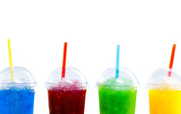 Row of Colorful Slush Drinks in Plastic Cups. Close Up Still Life of Frozen Fruit Slush Granita Drinks in Plastic Take Away Cups with Lids and Drinking Straws Stock Photos