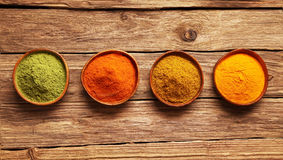 Row of colorful spices in bowls Royalty Free Stock Photo