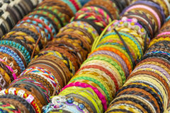 Row of colorful thread bracelets on jewelry market Royalty Free Stock Photography