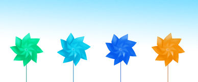 Row of Colorful Toy Pinwheels Stock Images