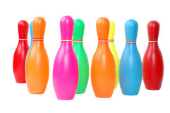 Row of colorful toy plastic bowling pins Royalty Free Stock Photos