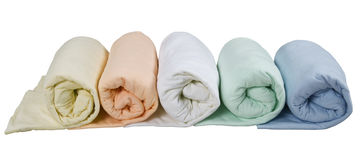 Row of colorful twisted blankets isolated on white background Royalty Free Stock Image