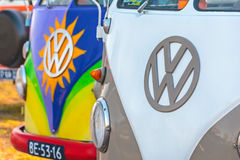 Row of colorful Volkswagen Transporter type 2 vans from the seve Stock Images