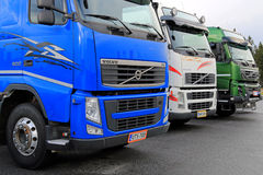 Row of Colorful Volvo Trucks Royalty Free Stock Photo