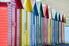 Row of colorful wooden beach huts Royalty Free Stock Photos