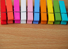 Row of colorful wooden pegs Stock Photography