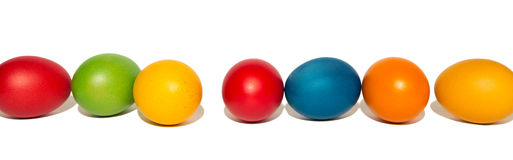 Row of coloured eggs, isolated Royalty Free Stock Image