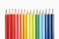 ROW OF COLOURED PENCILS SHOWING SPECTRUM COLOURS OF THE Stock Photography