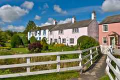 Row of coloured village cottages. A row of picturesque coloured cottages in the village of Caldbeck, Cumbria, in the English Lake District National Park stock images
