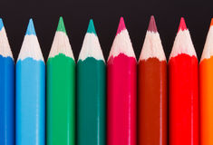 Row of coloured wood pencils Stock Images
