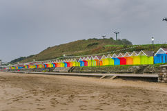 Row of Colourful Beach Huts on a Rainy Autumn Day Royalty Free Stock Photos