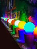 A row of Colourful light bulbs stock photo