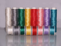 Row of colourful sewing threads with bobbins Royalty Free Stock Photo