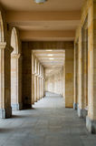 Row of column in colonnade. Perspective view of long arc vault corridor Stock Photography