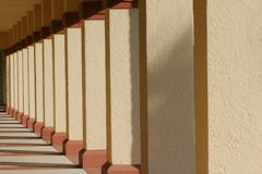 Row of Columns. A row of columns in an outdoor hallway Stock Photography