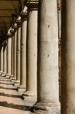 Row of columns on a Bologna street arcade, Italy.  Royalty Free Stock Photo