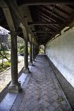 Row of columns. A covered pathway flanked with columns in the botanical gardens of Antwerp, Belgium royalty free stock image
