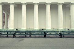 Row of columns and empty benches Stock Images